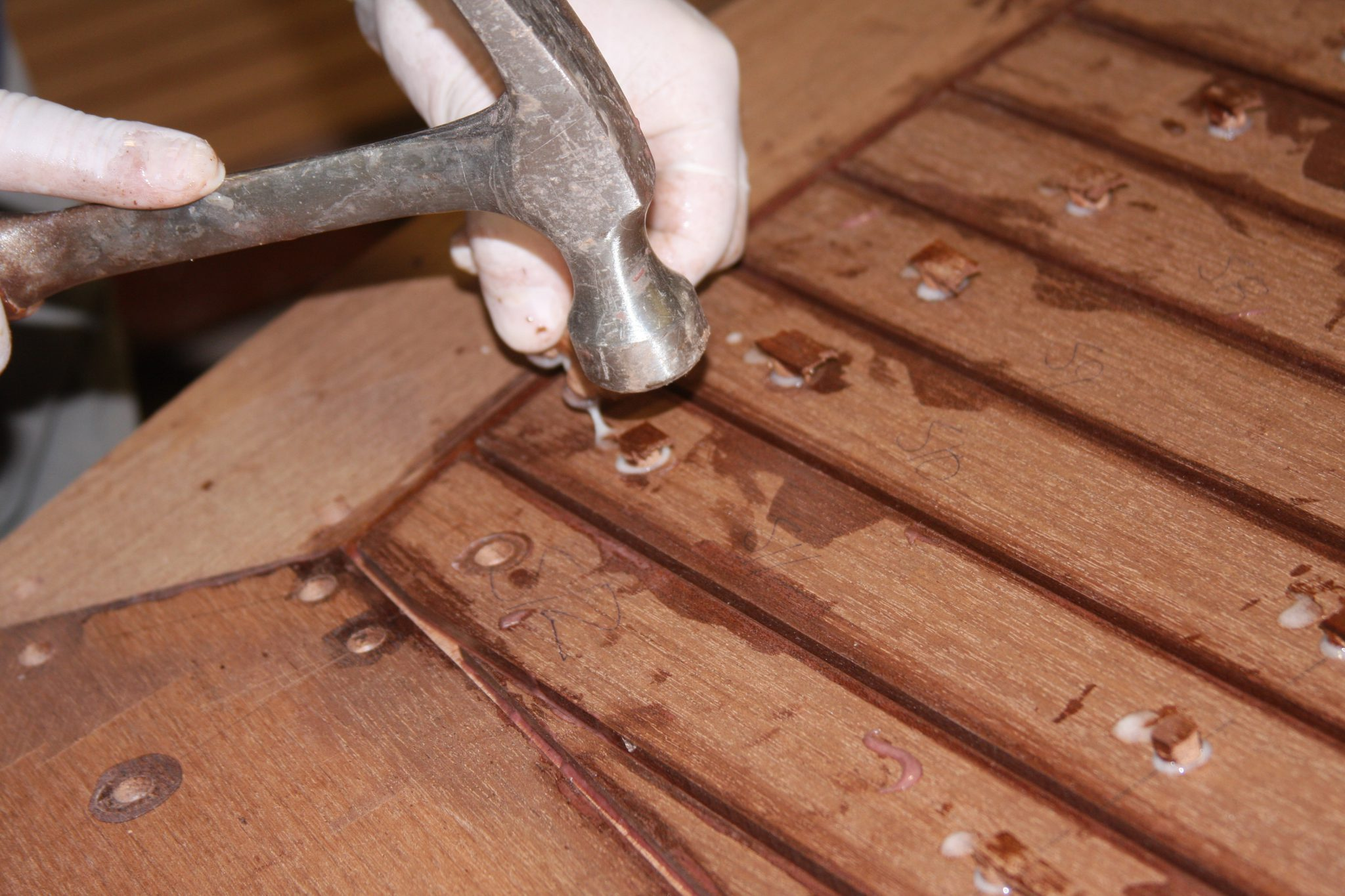 Filling screw holes with hand made mahogany plugs