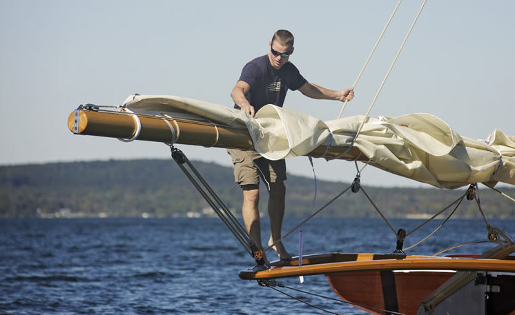 Ben Van Dam adjusting sails on Tattler II
