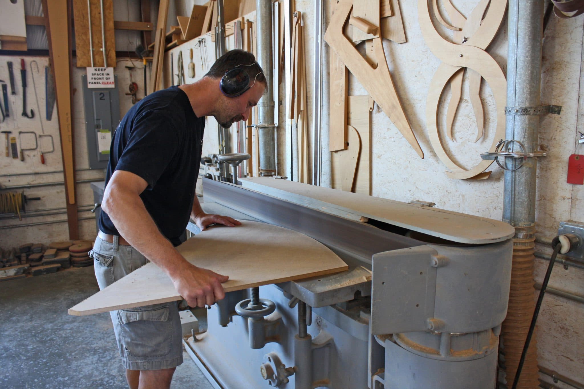 Master craftsman shaping flooring