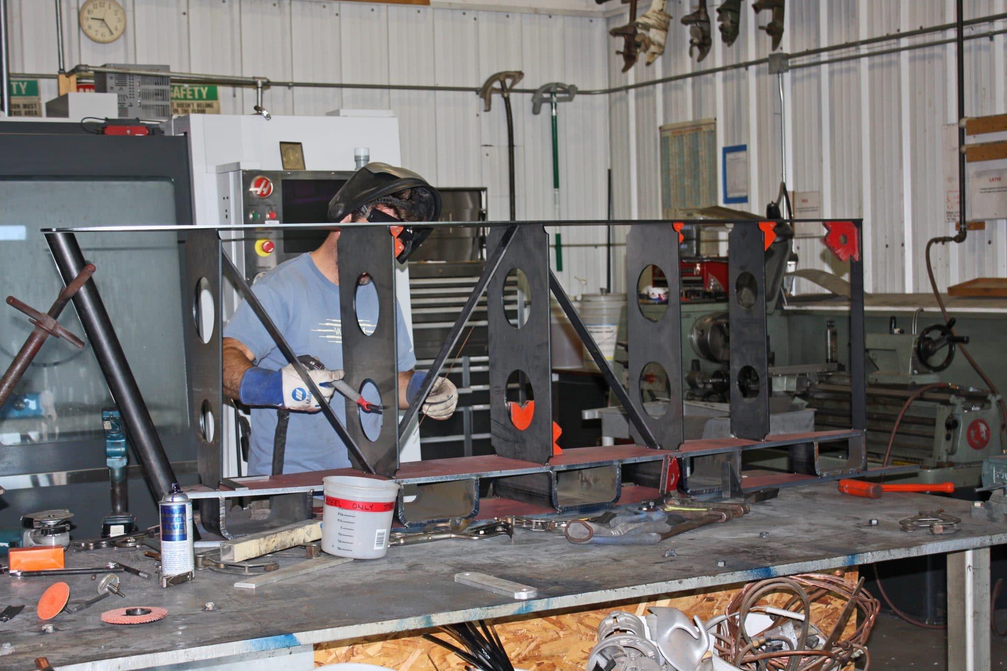 Custom fuel tank being welded in metal shop