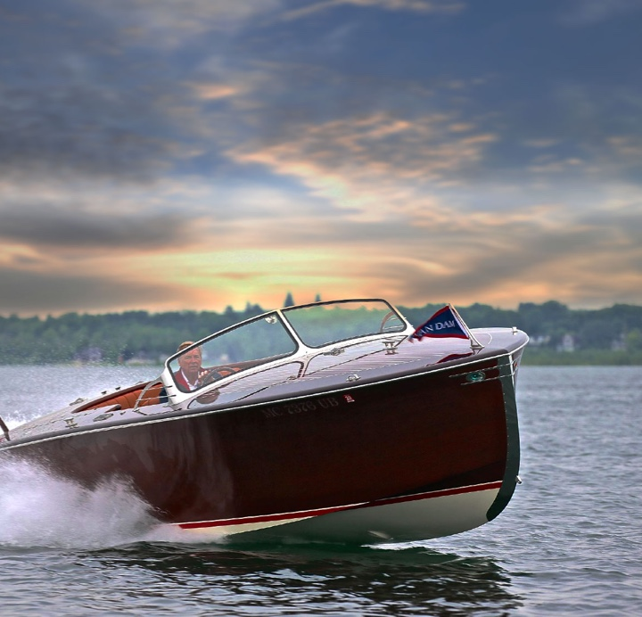 A custom Van Dam power boat sailing on the water.