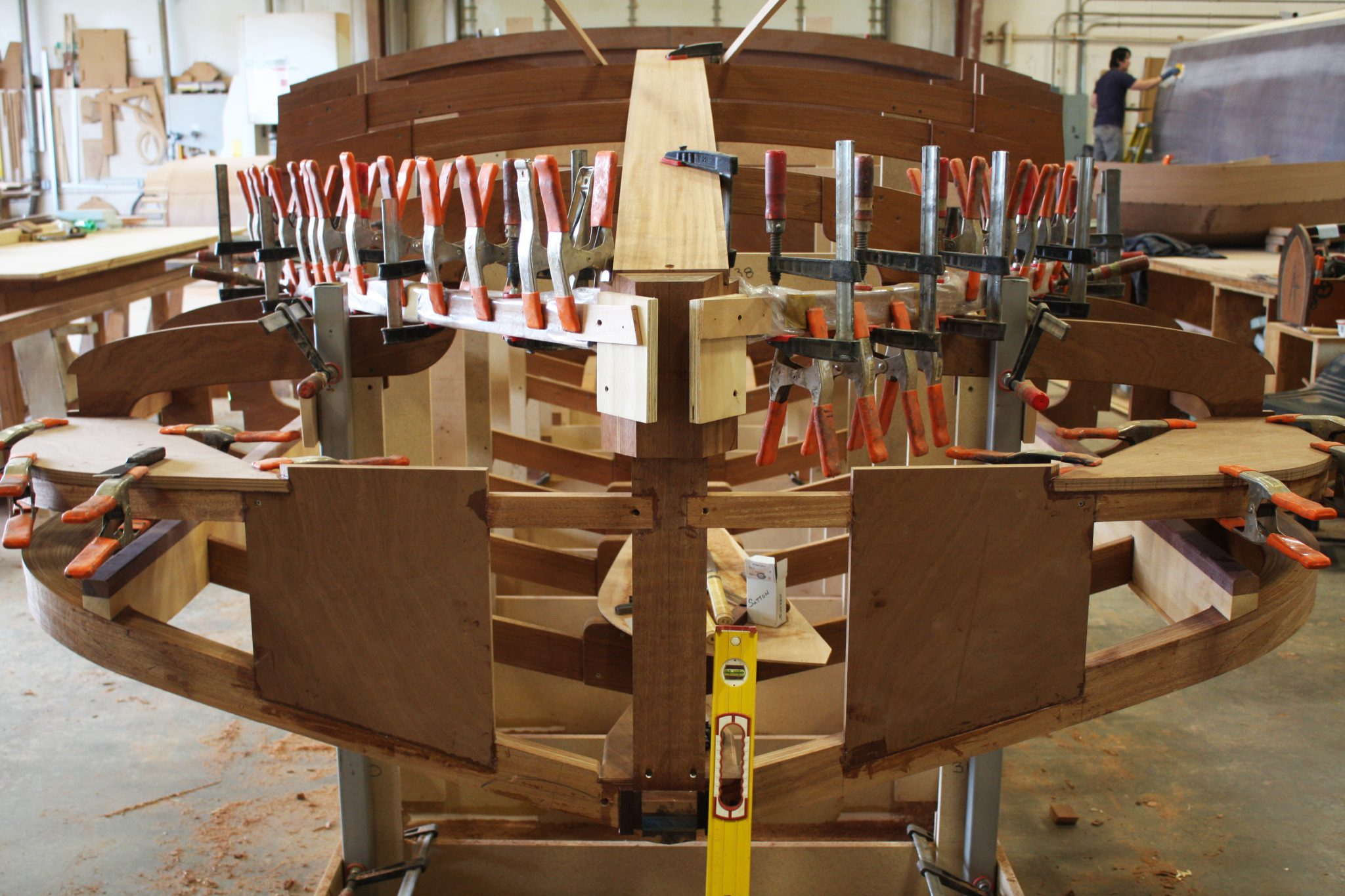 Clamping ribs into place to dry as new shape