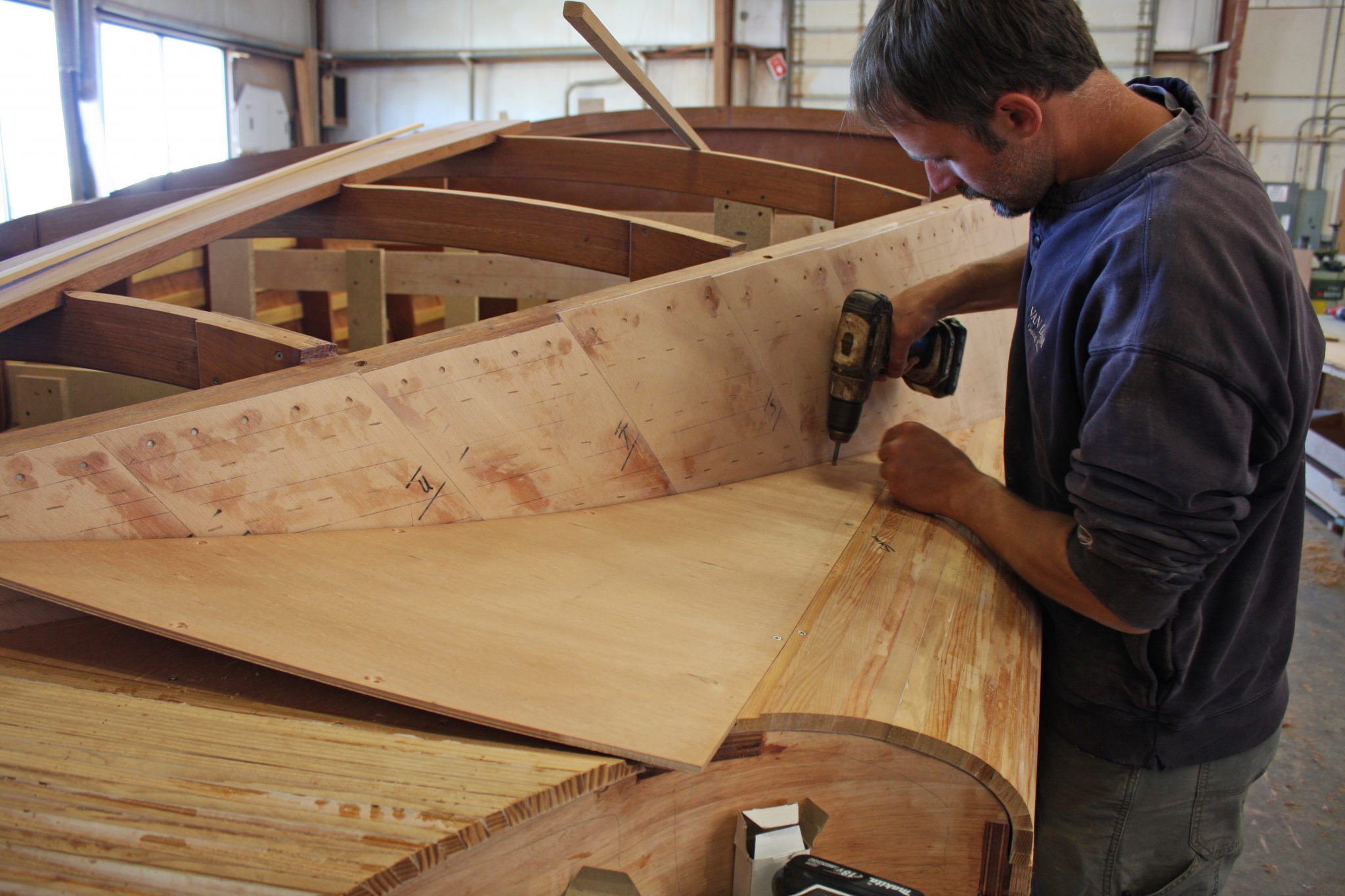Adhering final layer of planking to hull