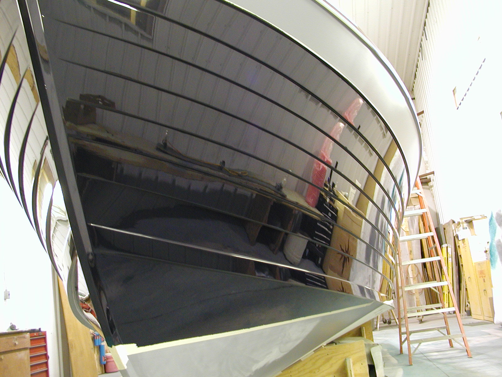 Hull being painted in paint bay on Chocolate Chip 3
